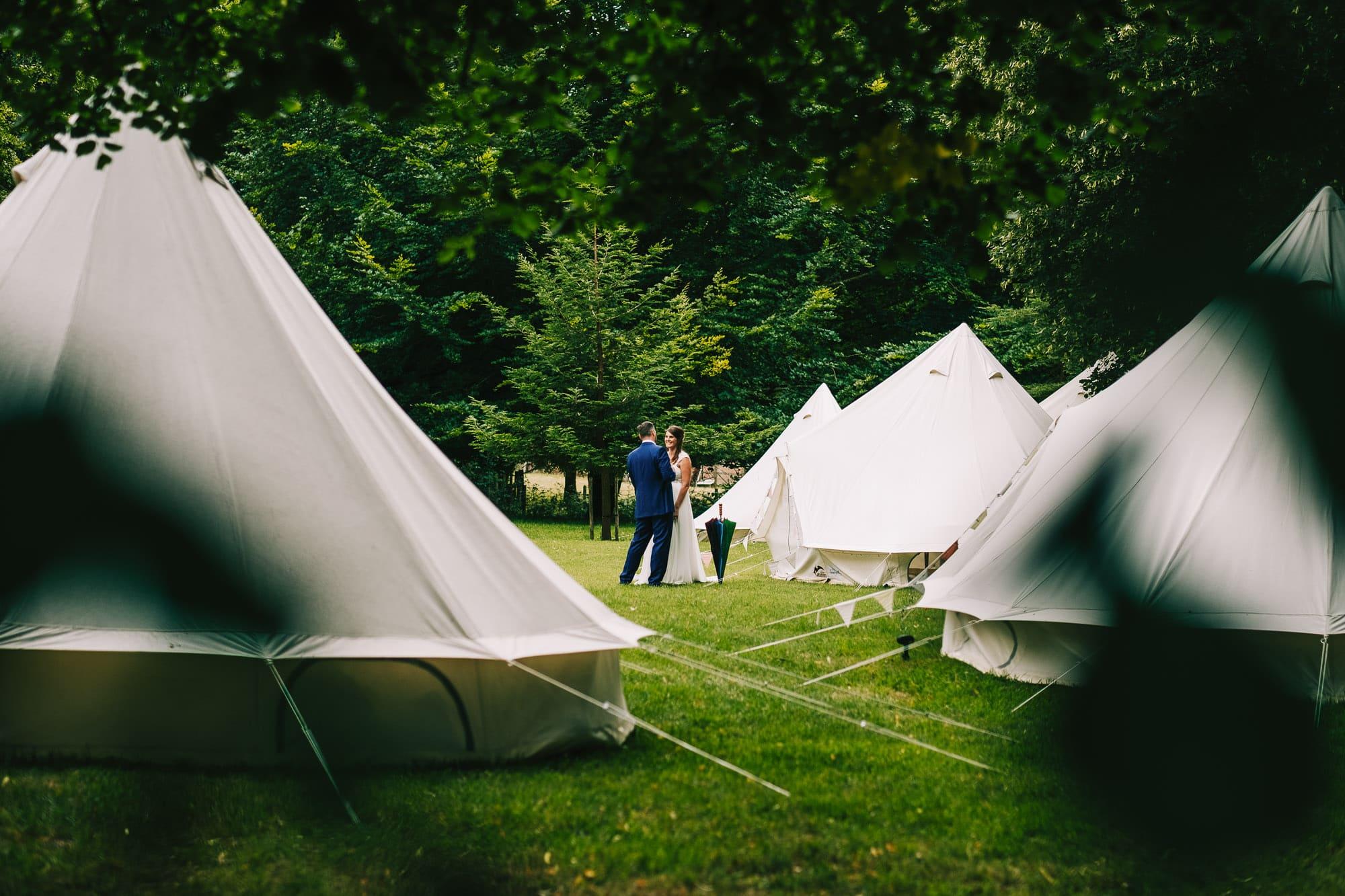 Canterbury Wedding Photographer - Bride and mum laugh during bridal prep