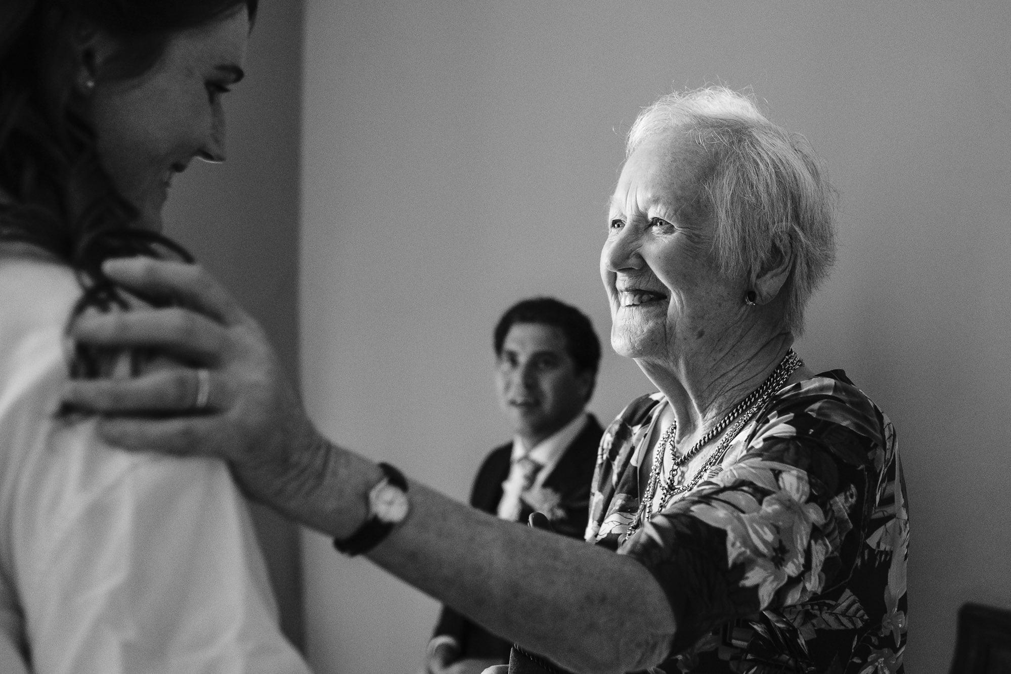 Canterbury Wedding Photographer - Bride and bridesmaids laughing