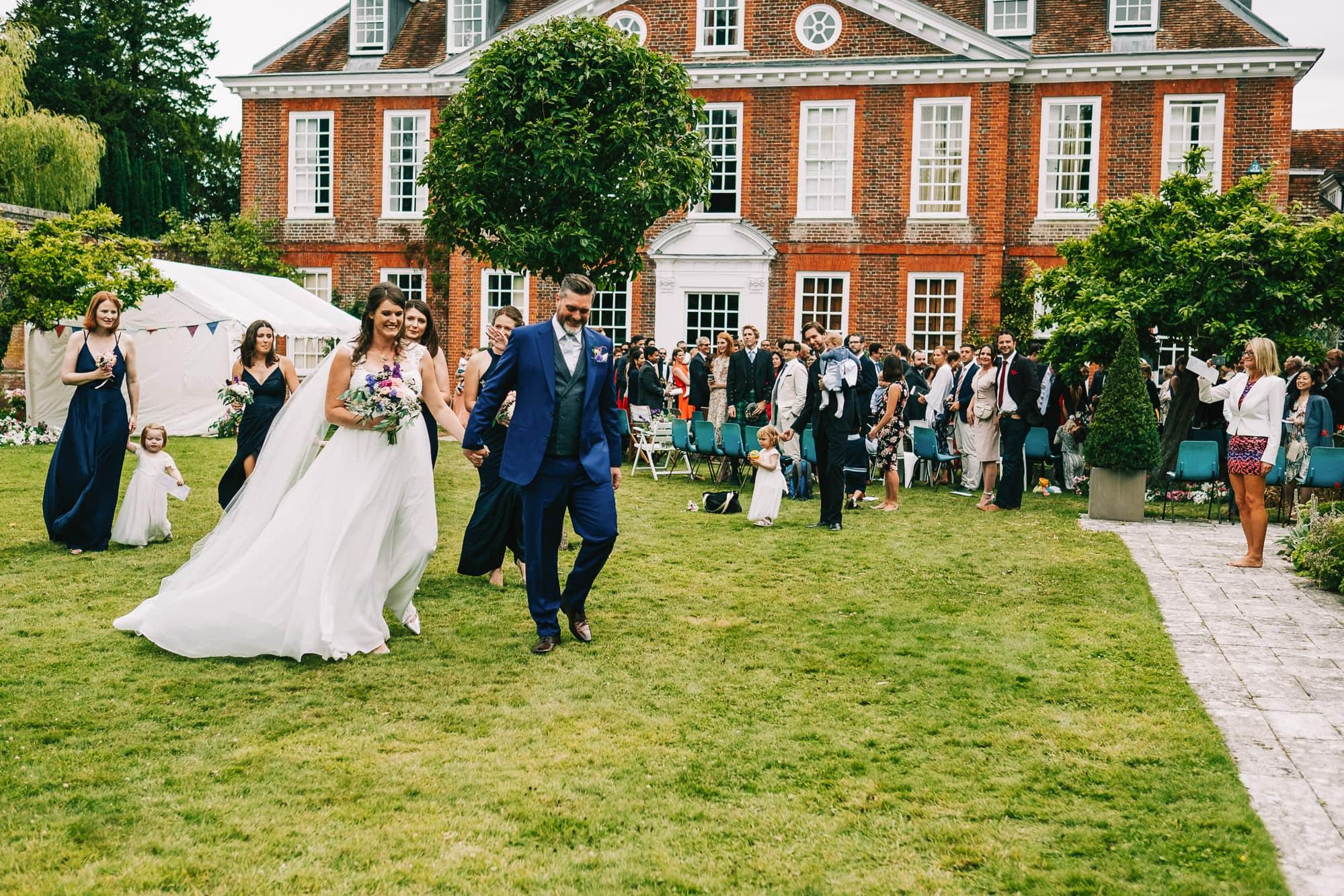 Canterbury Wedding Photographer - Groom doing up his tie
