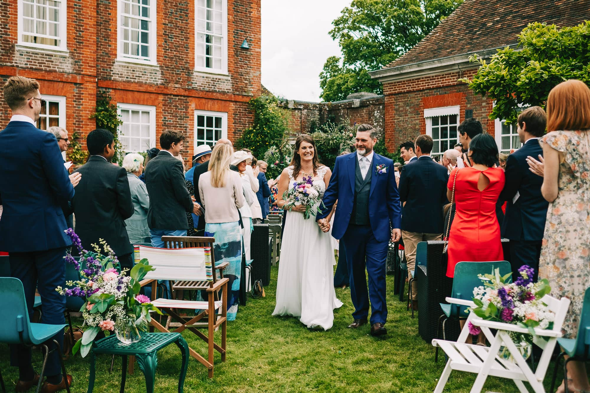 Canterbury Wedding Photographer - Groom laughs with his bestman