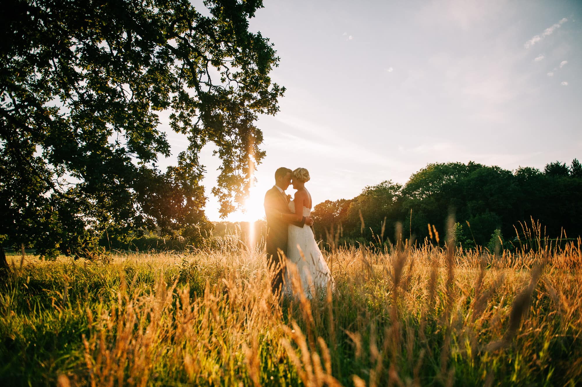 Bride and groom in the fields at Hockering House