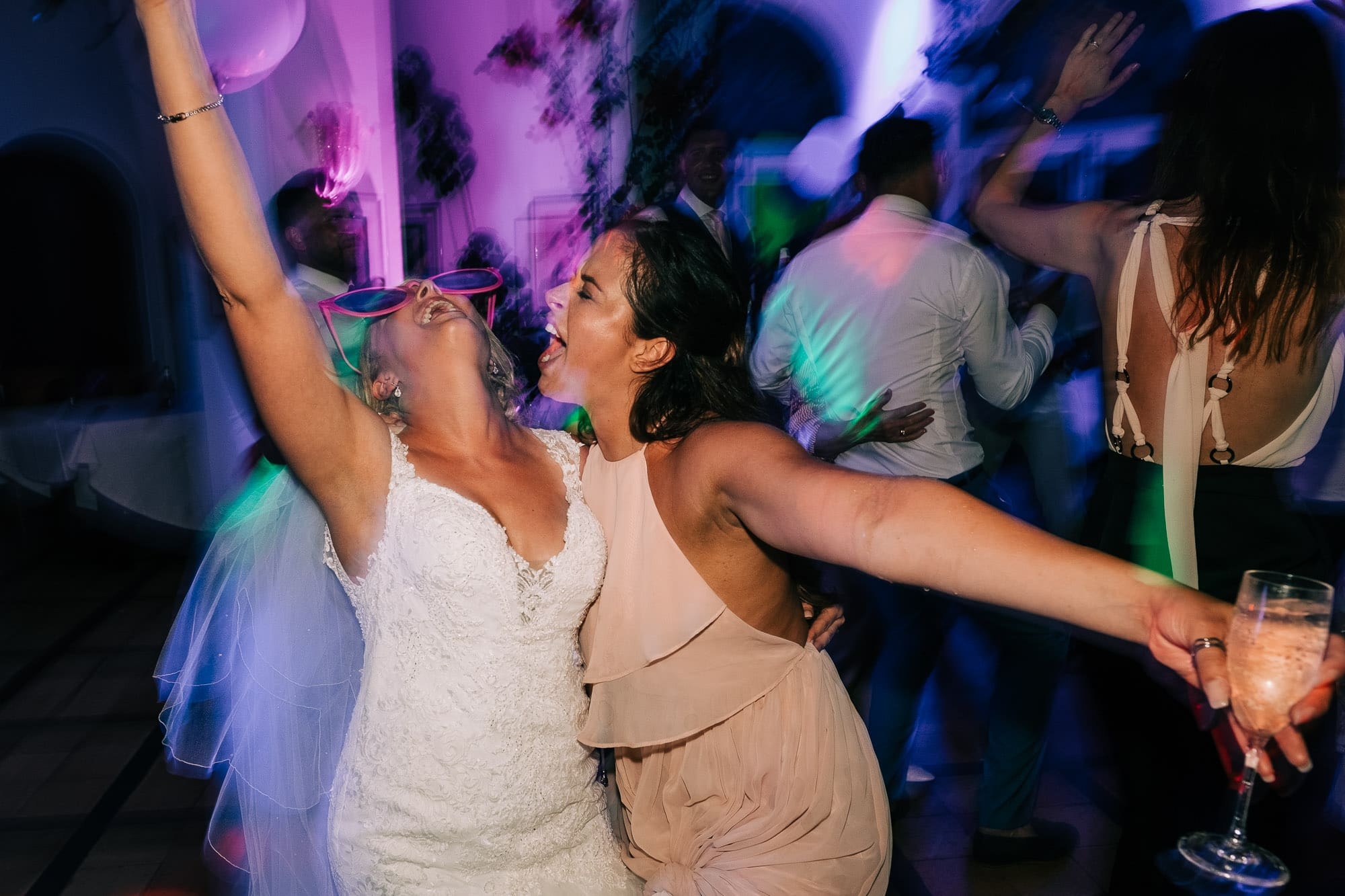 Bride and bridesmaid dancing at Villa Eva