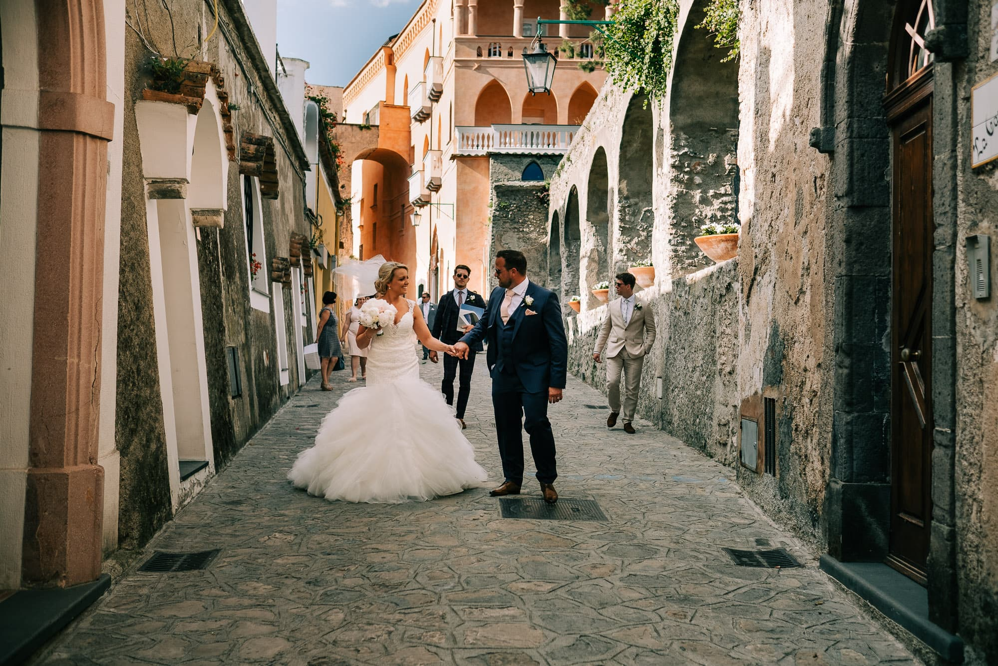 Bride and groom walking through the streets of Ravello