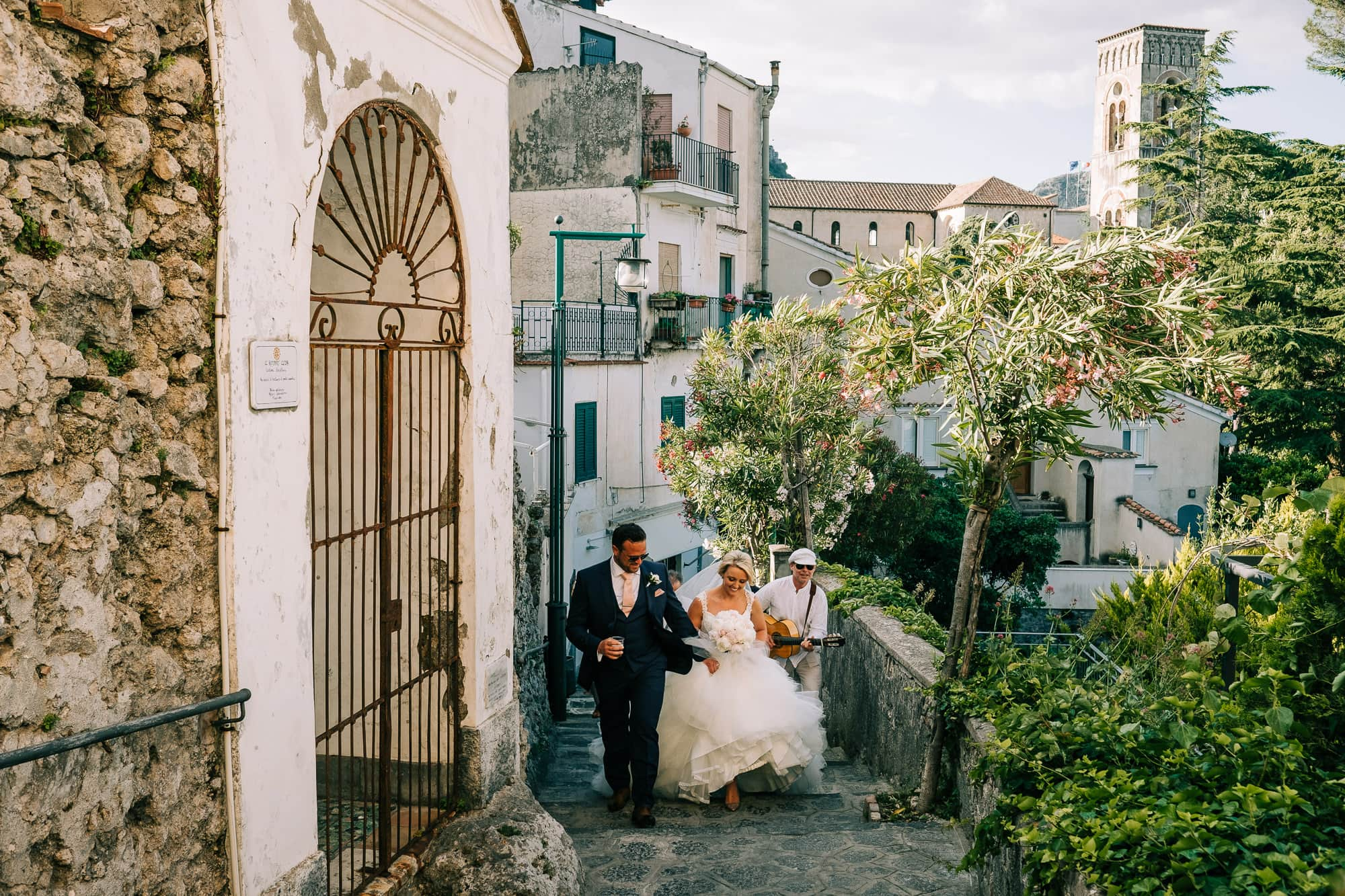 Bride and groom climbing the steps to Villa Eva