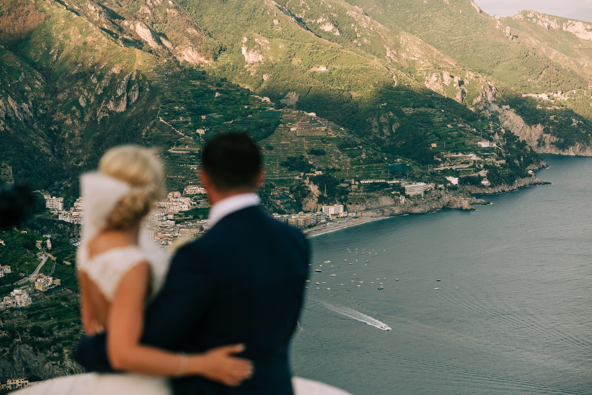 Bride and groom looking at the Amalfi coastline from the roof of Villa Eva