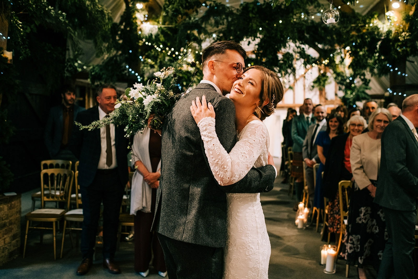 Louise and Steve have a cuddle when she reaches him at the end of the aisle