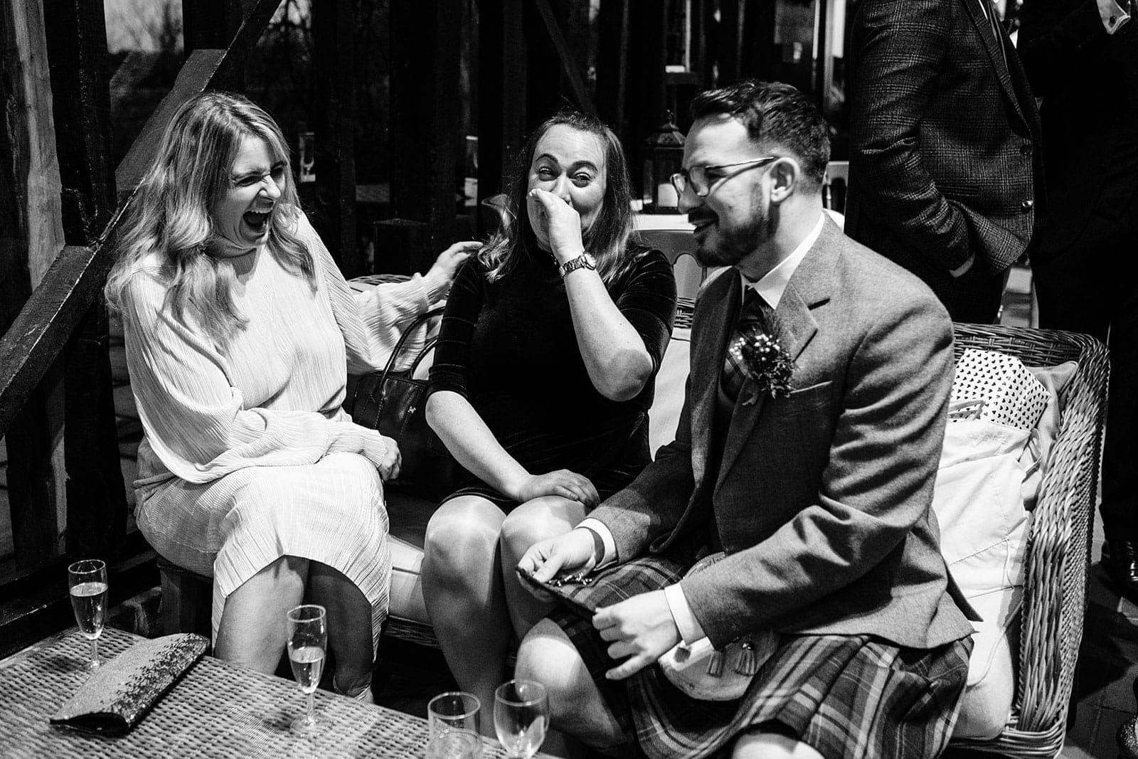 Wedding guests having a laugh