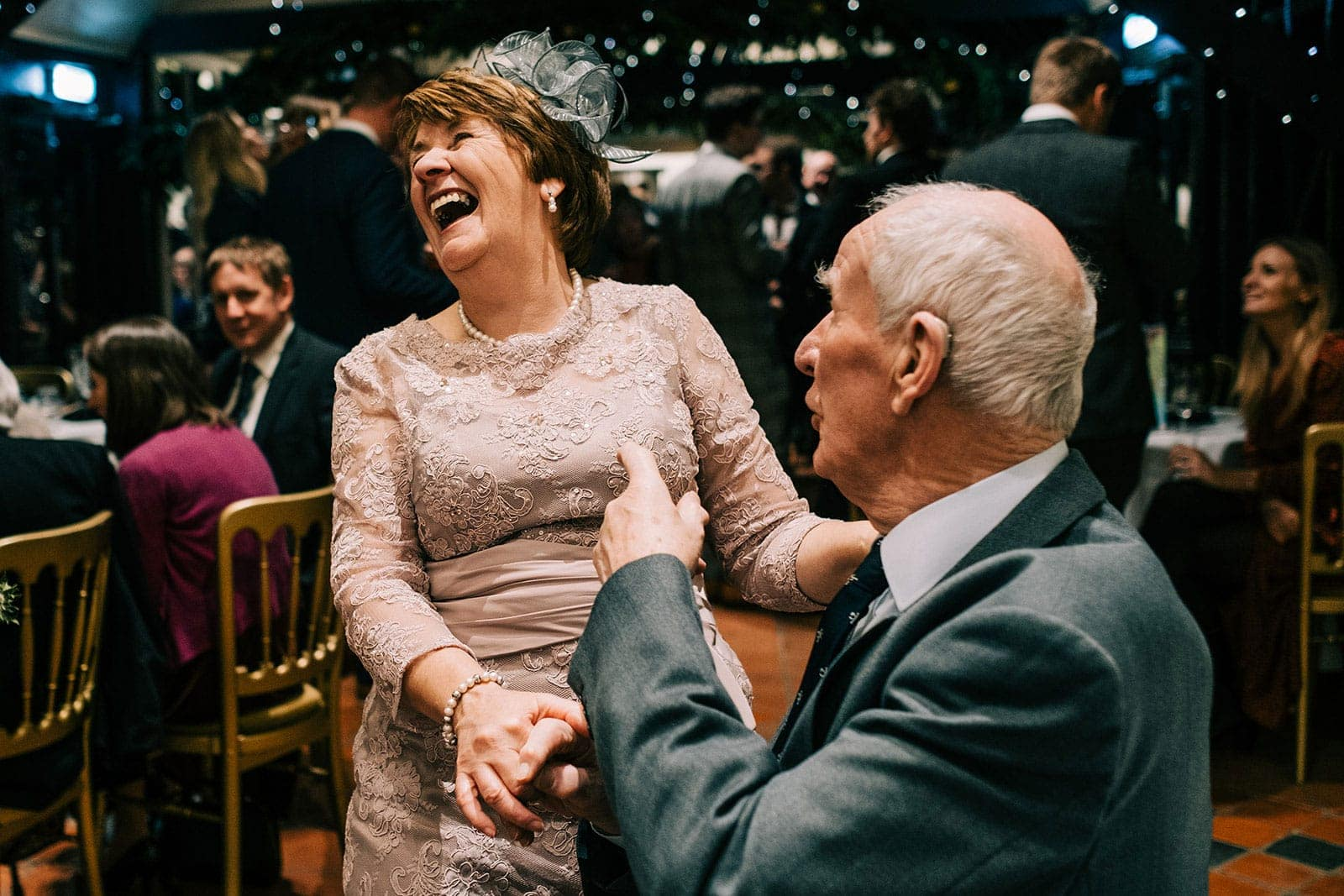 Louise's auntie laughs during the drinks reception