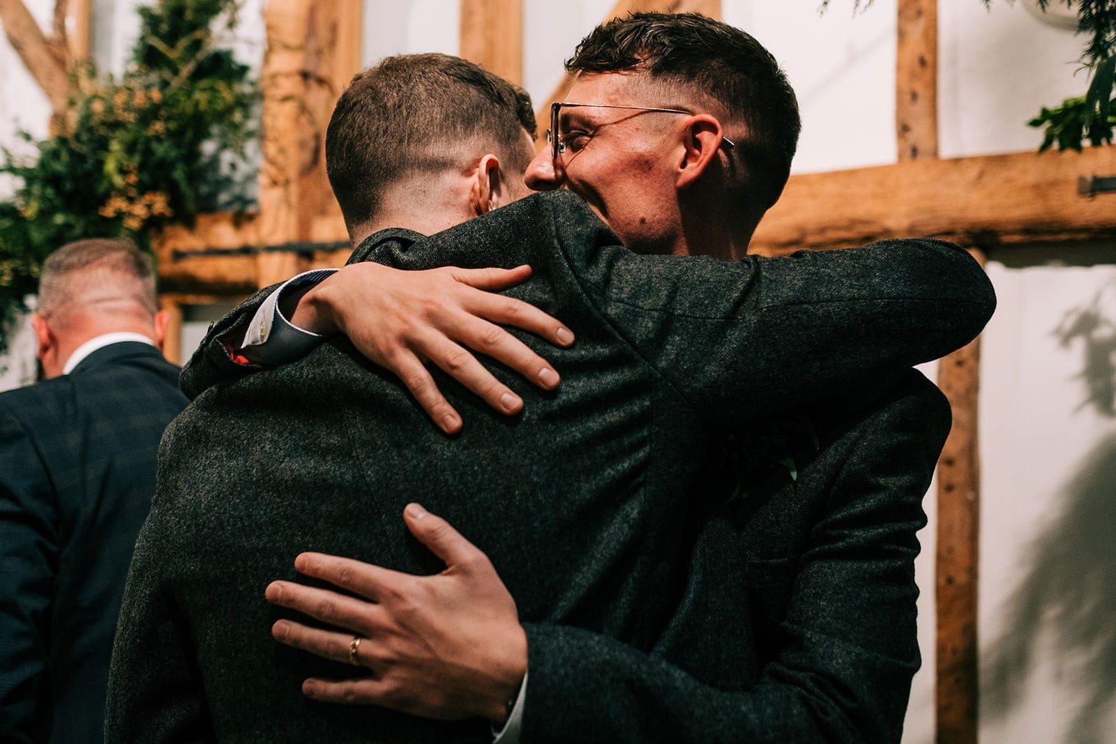 Steve hugs his best man after his speech