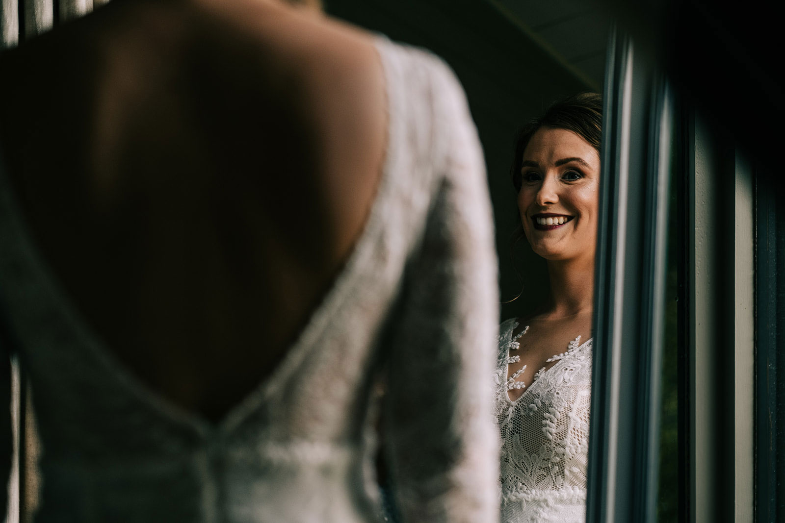 Louise looks into the mirror before the ceremony