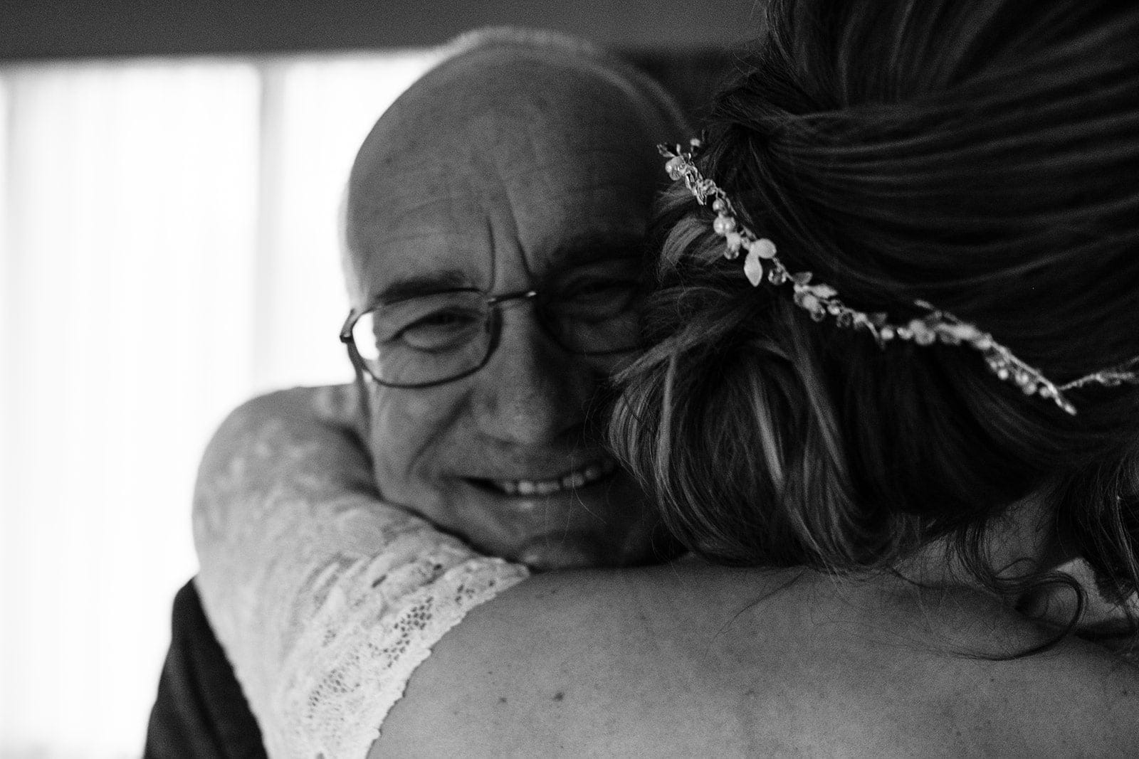 Louise hugs her dad after he sees her in the dress