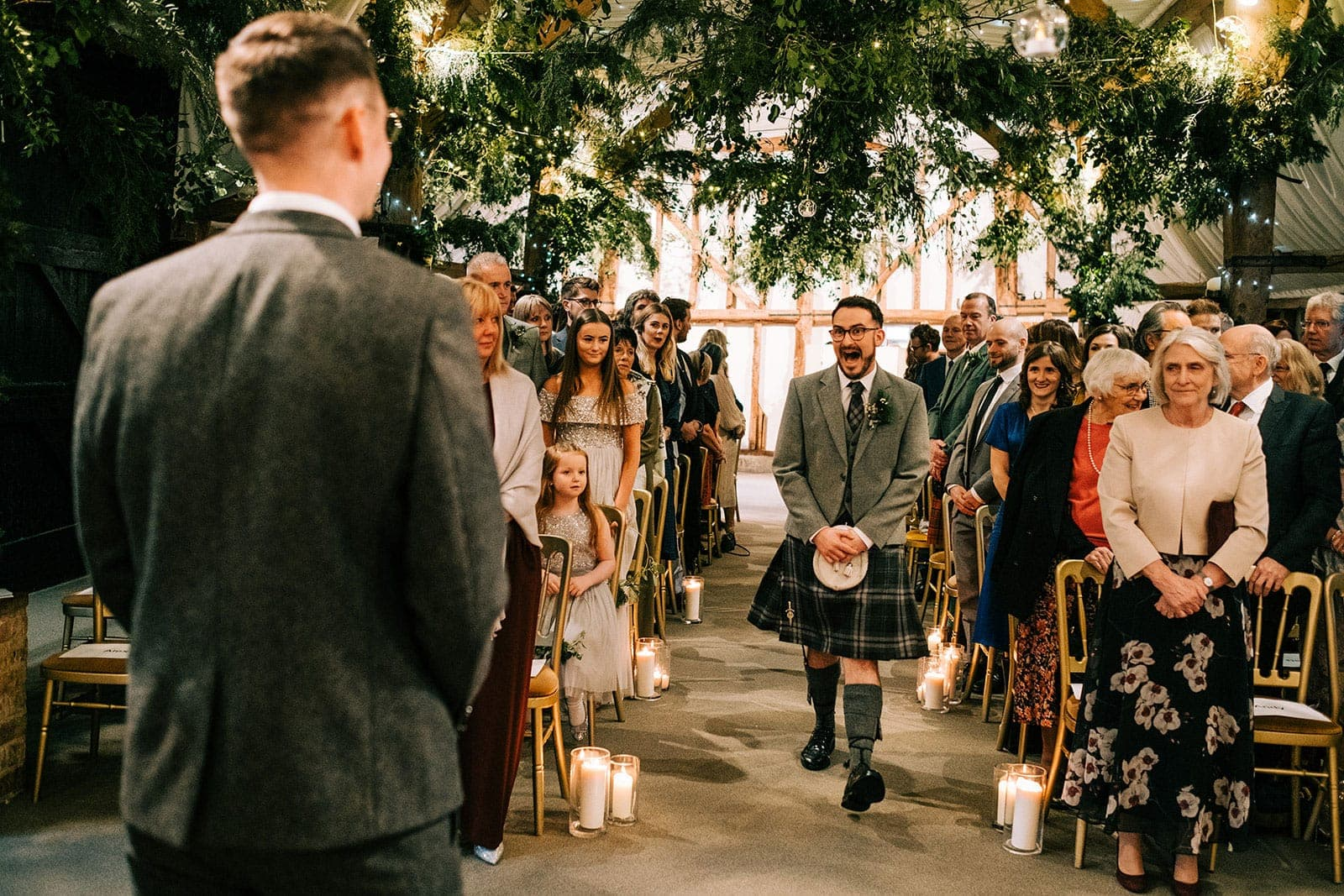Louise's brideman pulls a face when coming down the aisle