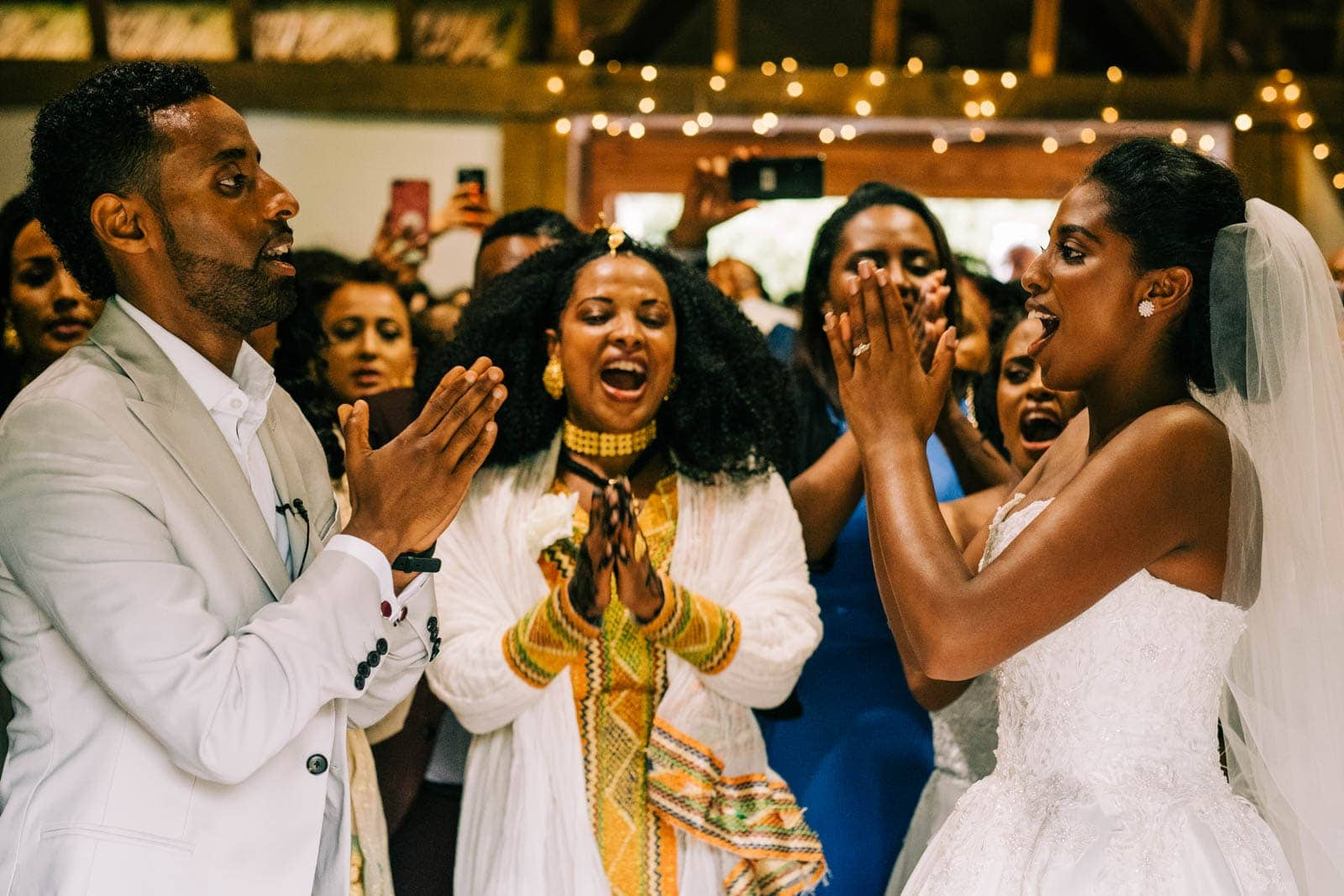 The wedding party celebrate during the ceremony with a Ethiopian dance