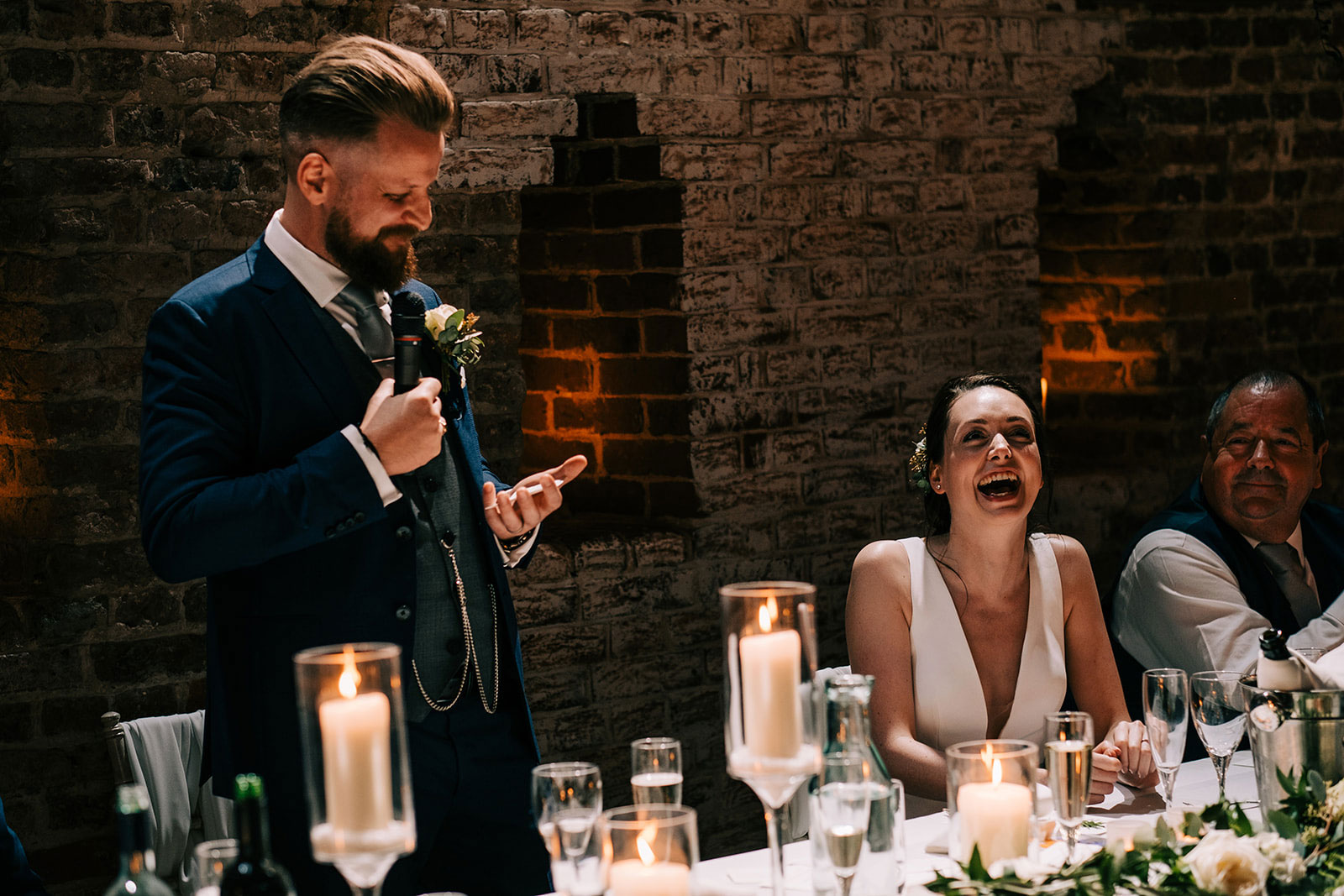 Jack makes Jacquie laugh during his speech
