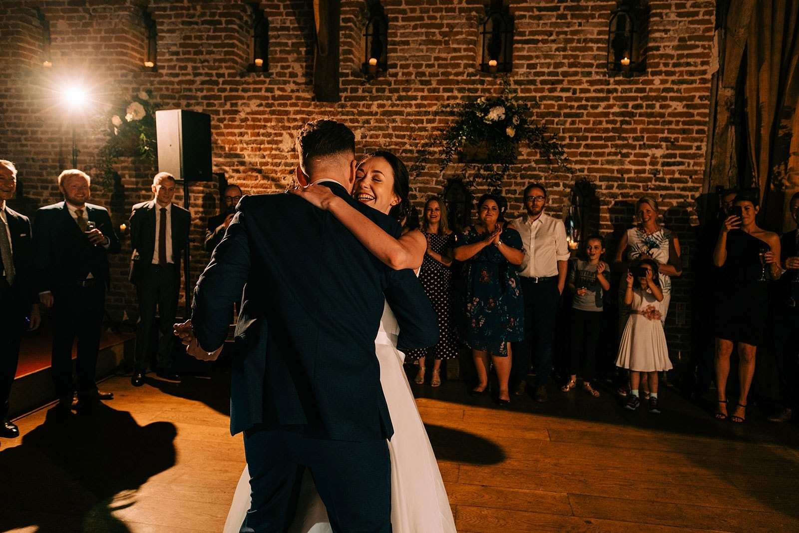 Jacquie has a beaming smile during their first dance