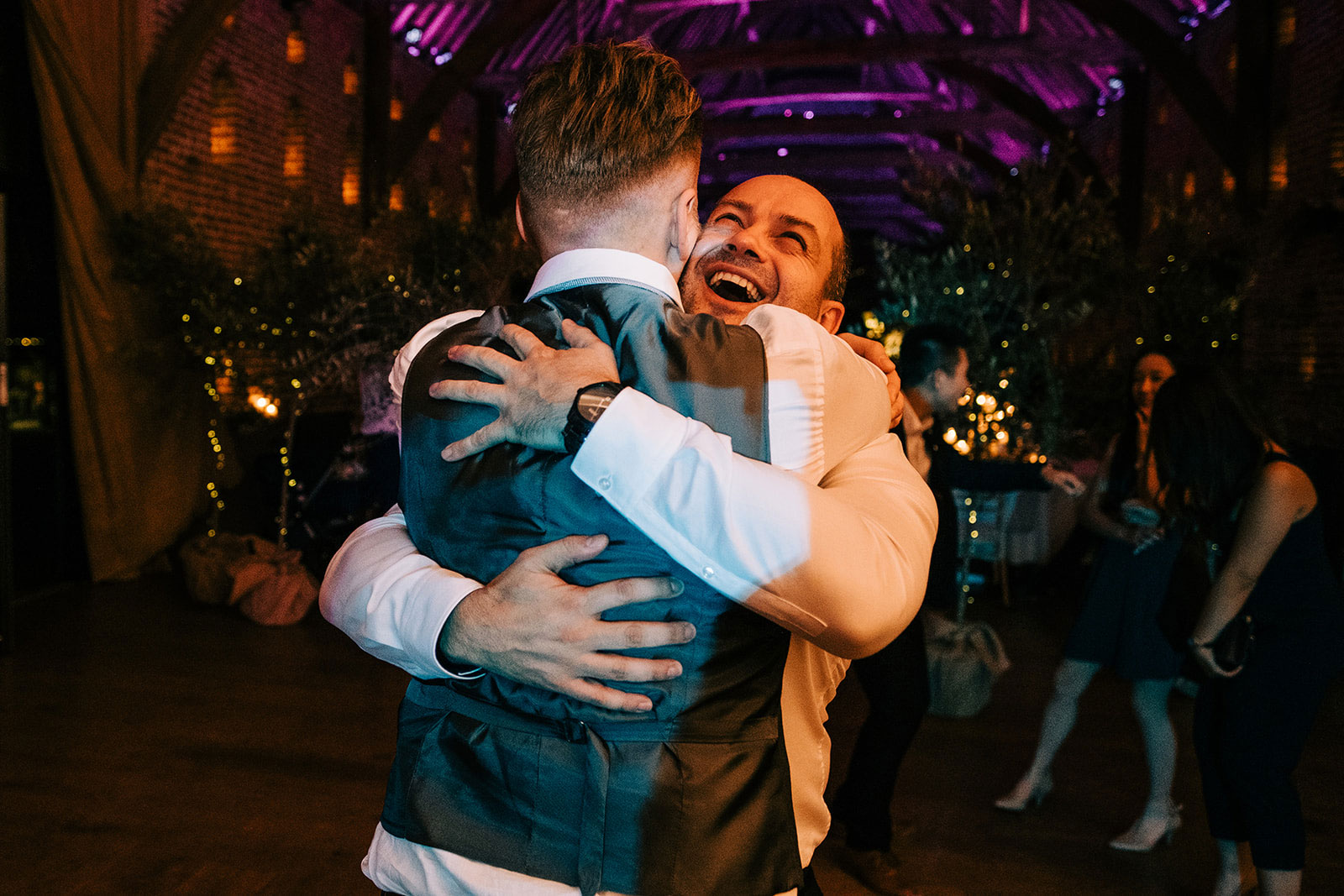 Jack hugs one of his friends on the dance floor