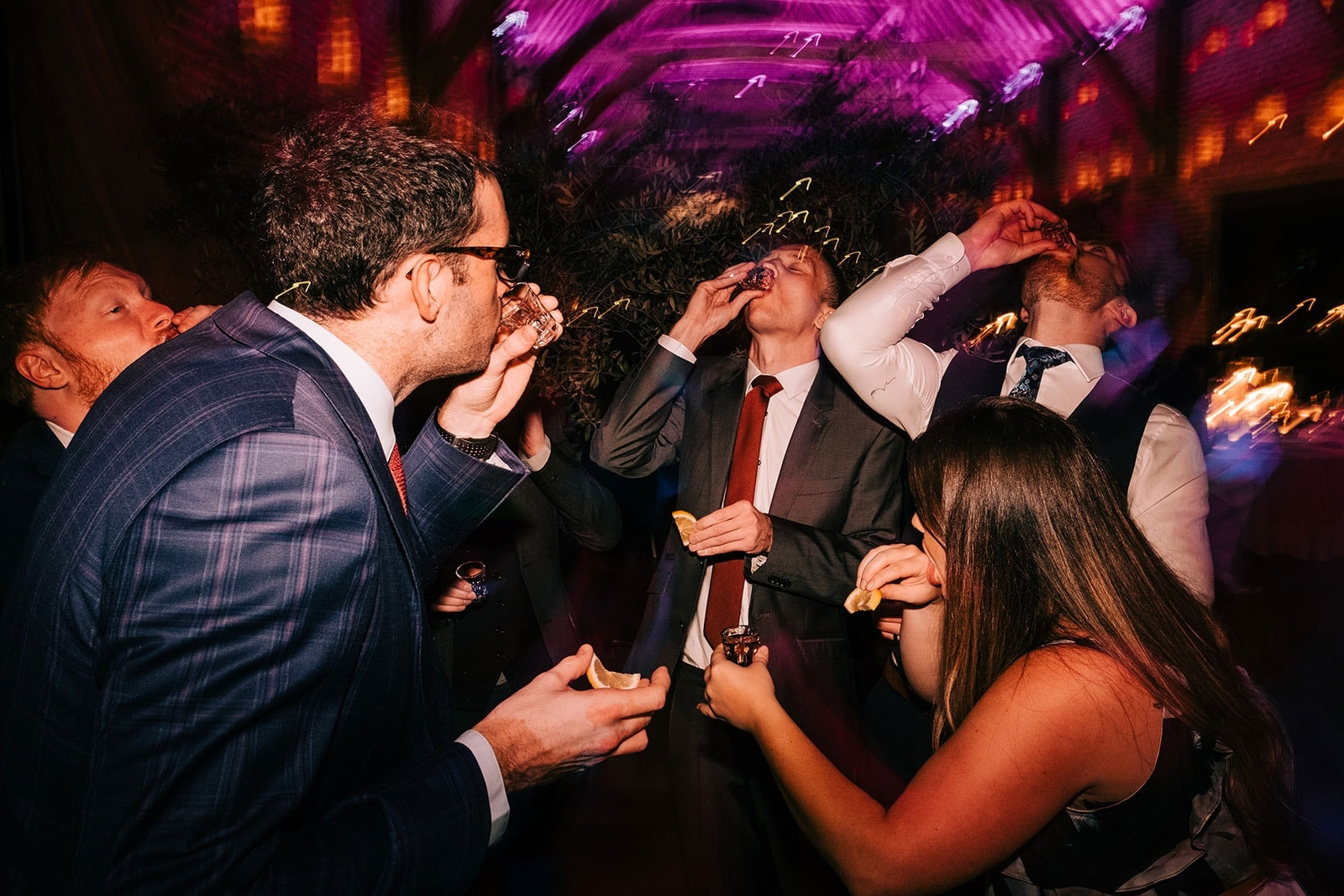 Guests do shots on the dance floor