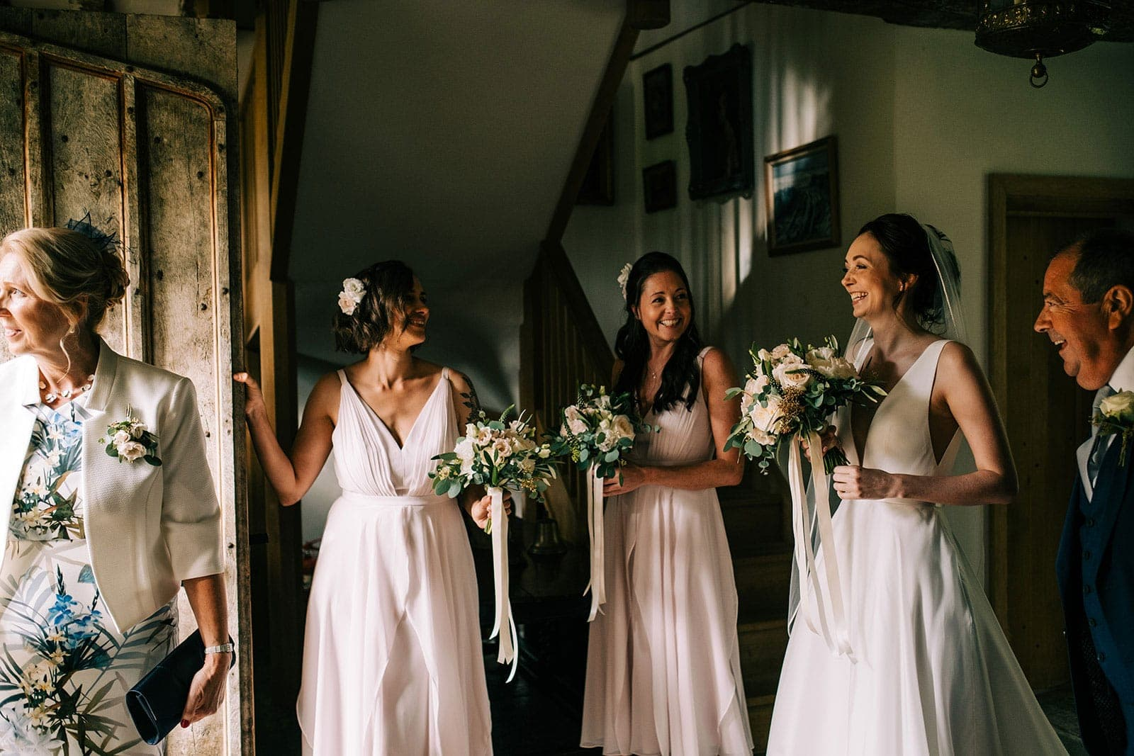 Jacquie, her bridesmaids and her parents wait to be called by the wedding planner
