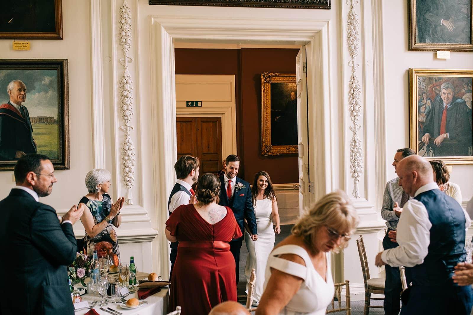 Yasmin and Leigh enter the wedding breakfast room