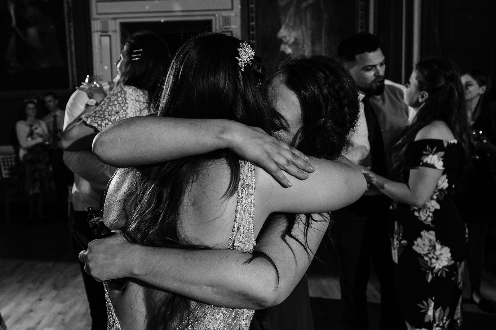 Yasmin hugs her friend on the dance floor