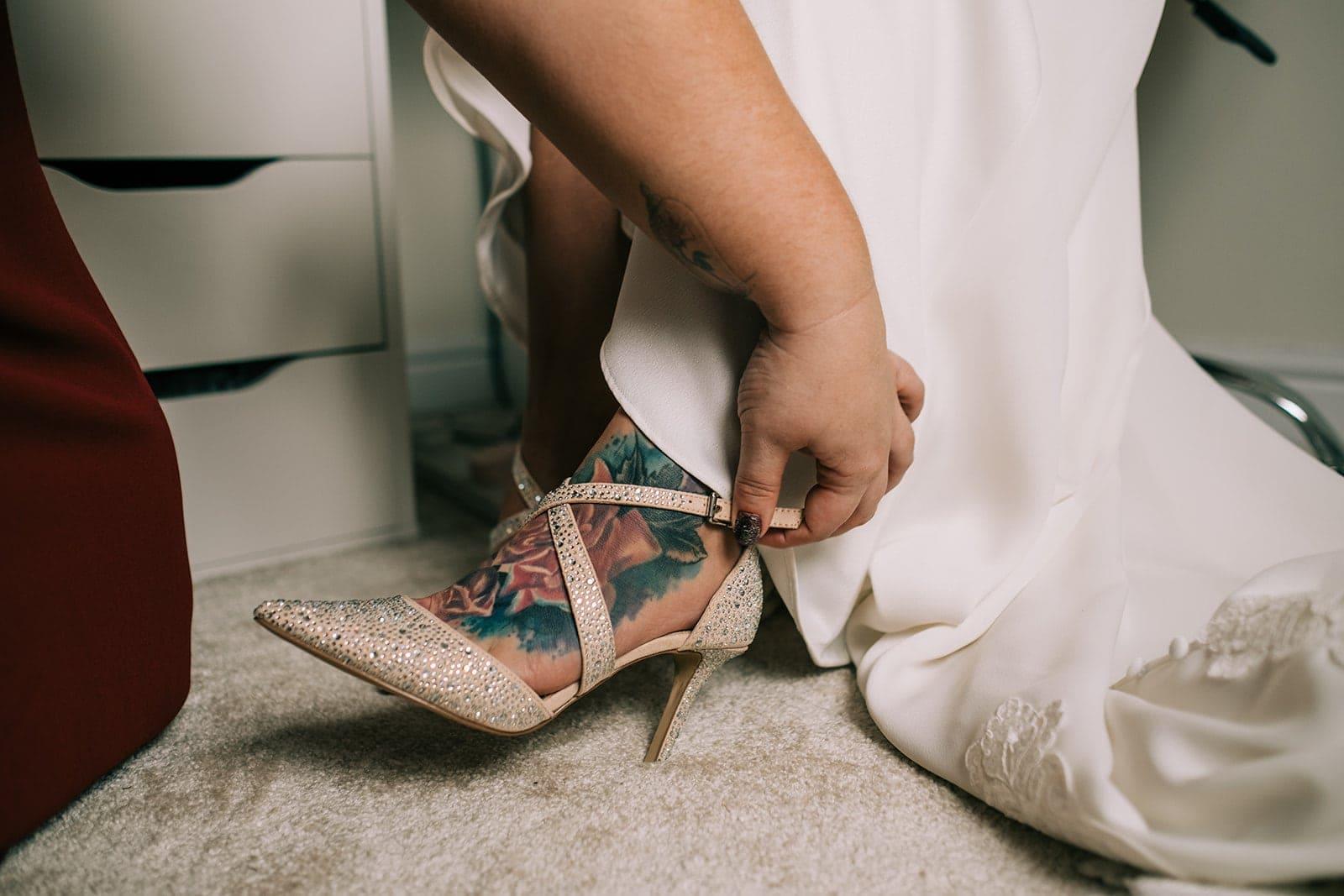 Yasmin putting her wedding shoes on
