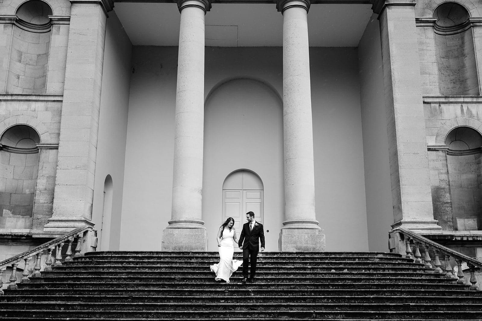 Yasmin and Leigh walk down the Kimbolton Castle steps
