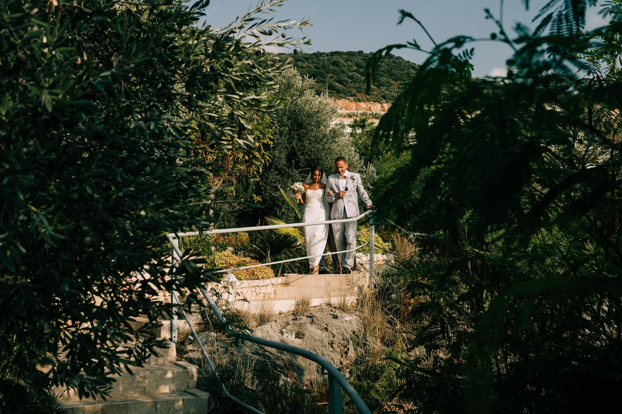 Bride and dad walk down the Villa to the ceremony in Kalkan