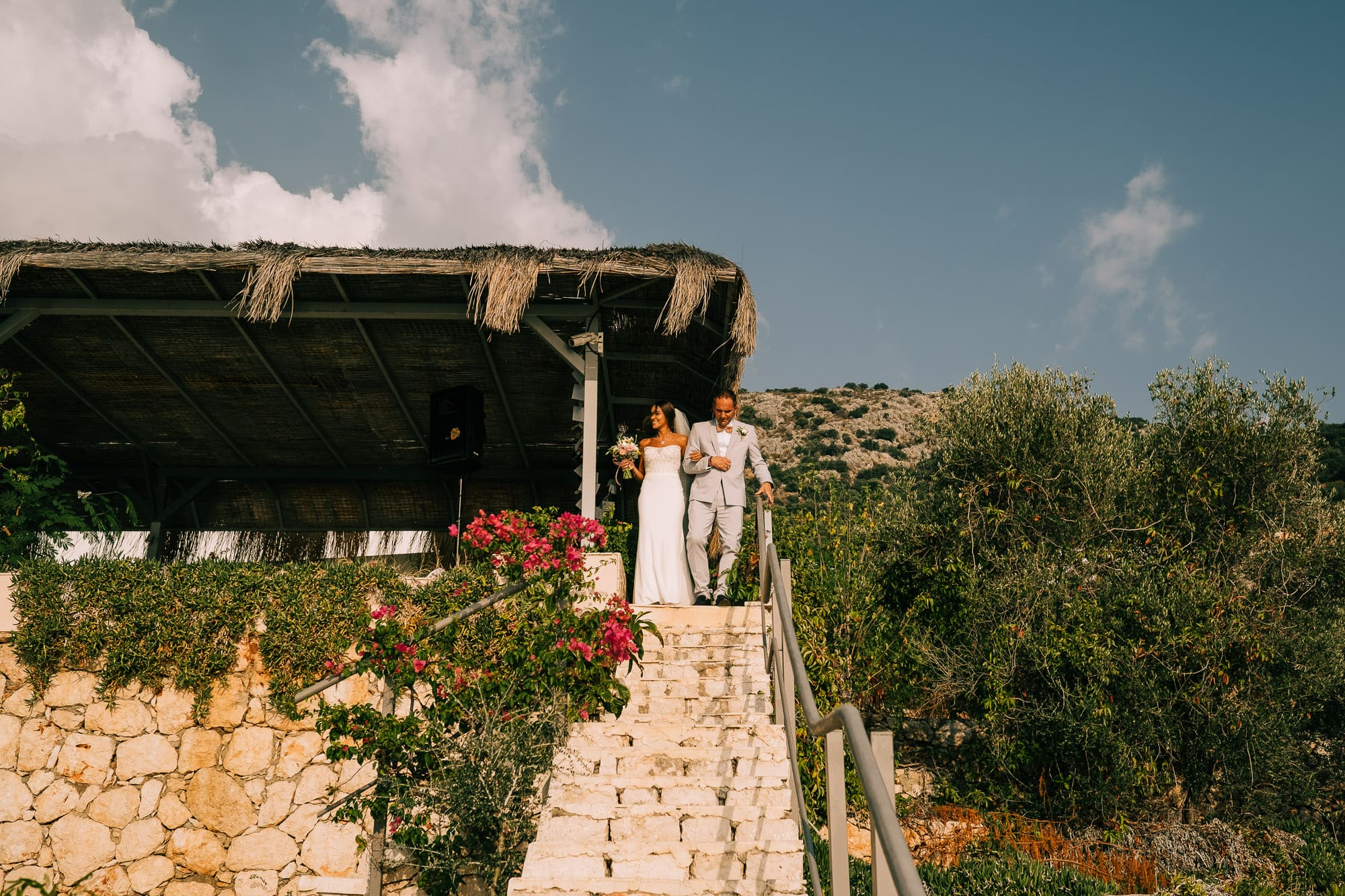 Bride and dad walking down the Villa Mavi Koy steps to the ceremony on the shore of Kalkan