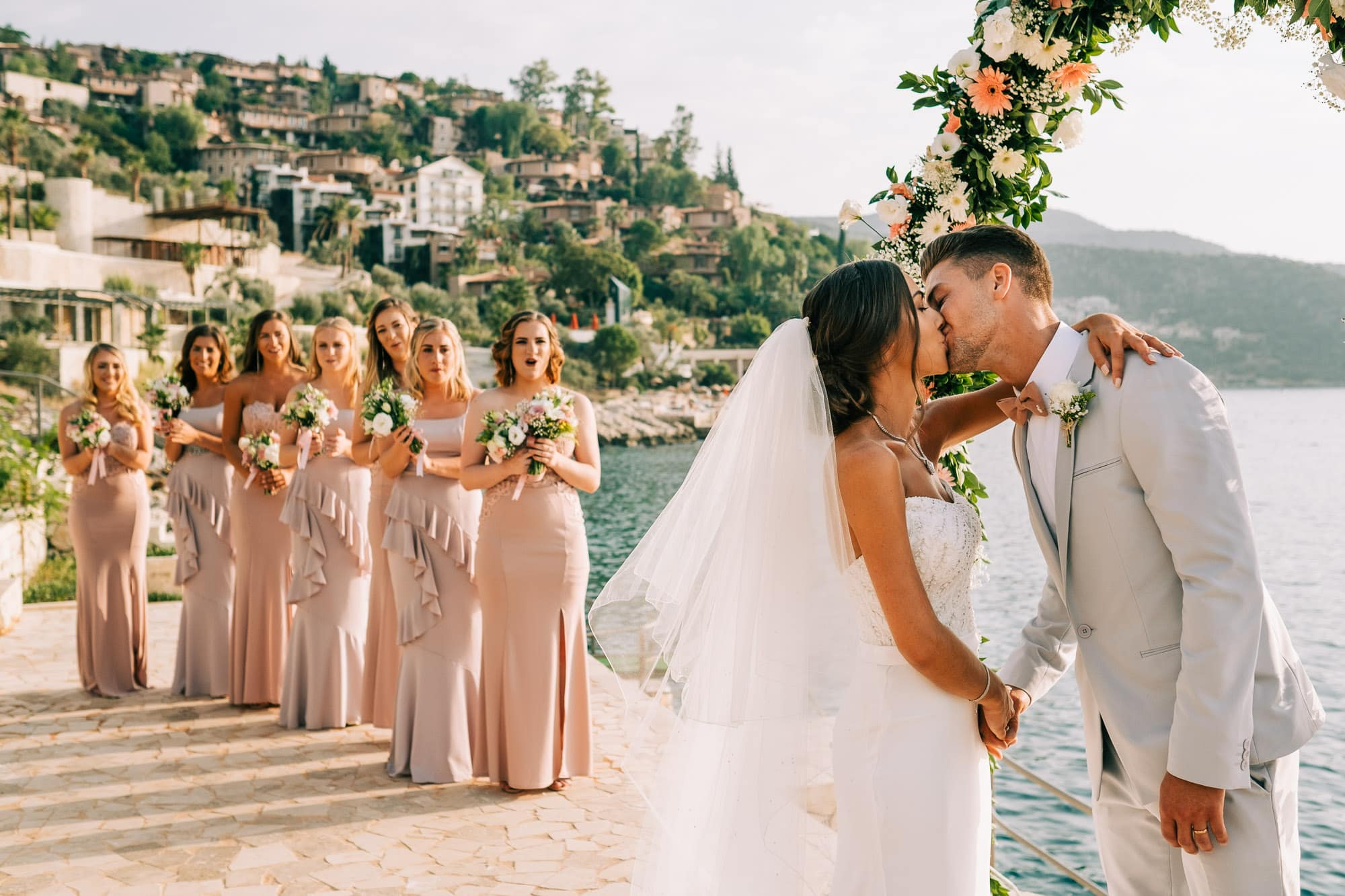 Bride and groom kiss after their Kalkan wedding ceremony