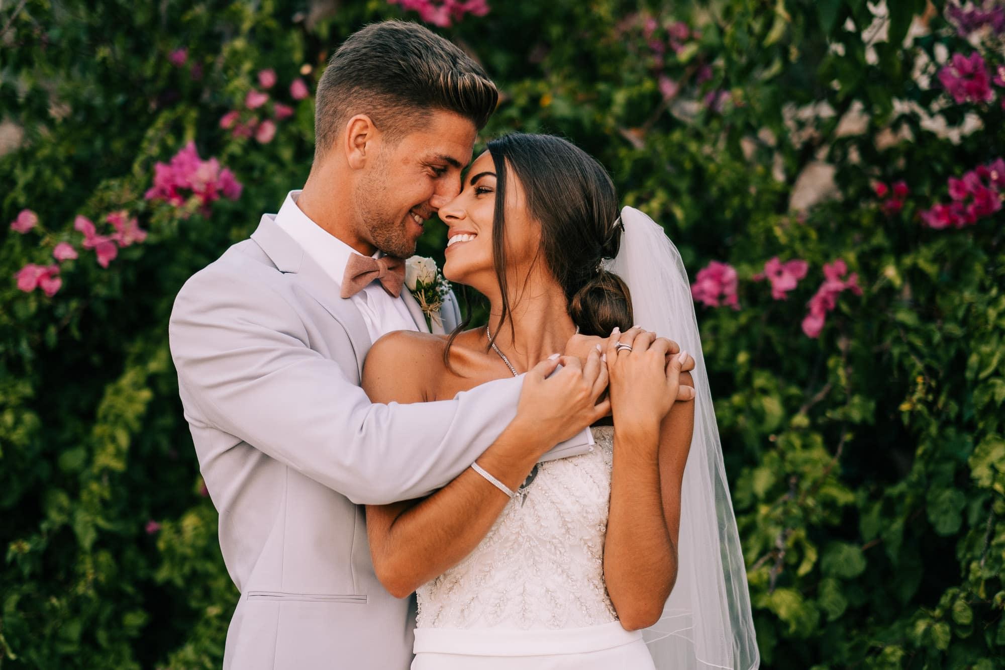 Bride and groom cuddle in Kalkan, Turkey