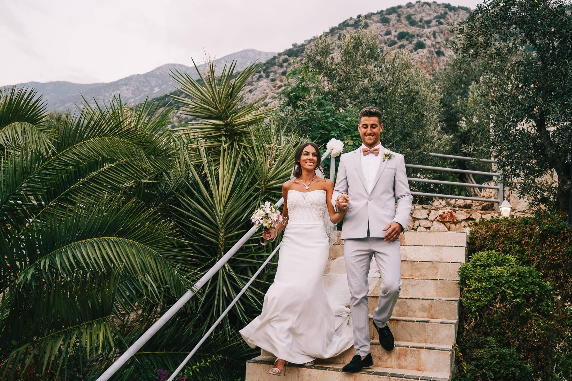 Bride and groom walking to the reception in Villa Mavi Koy in Kalkan