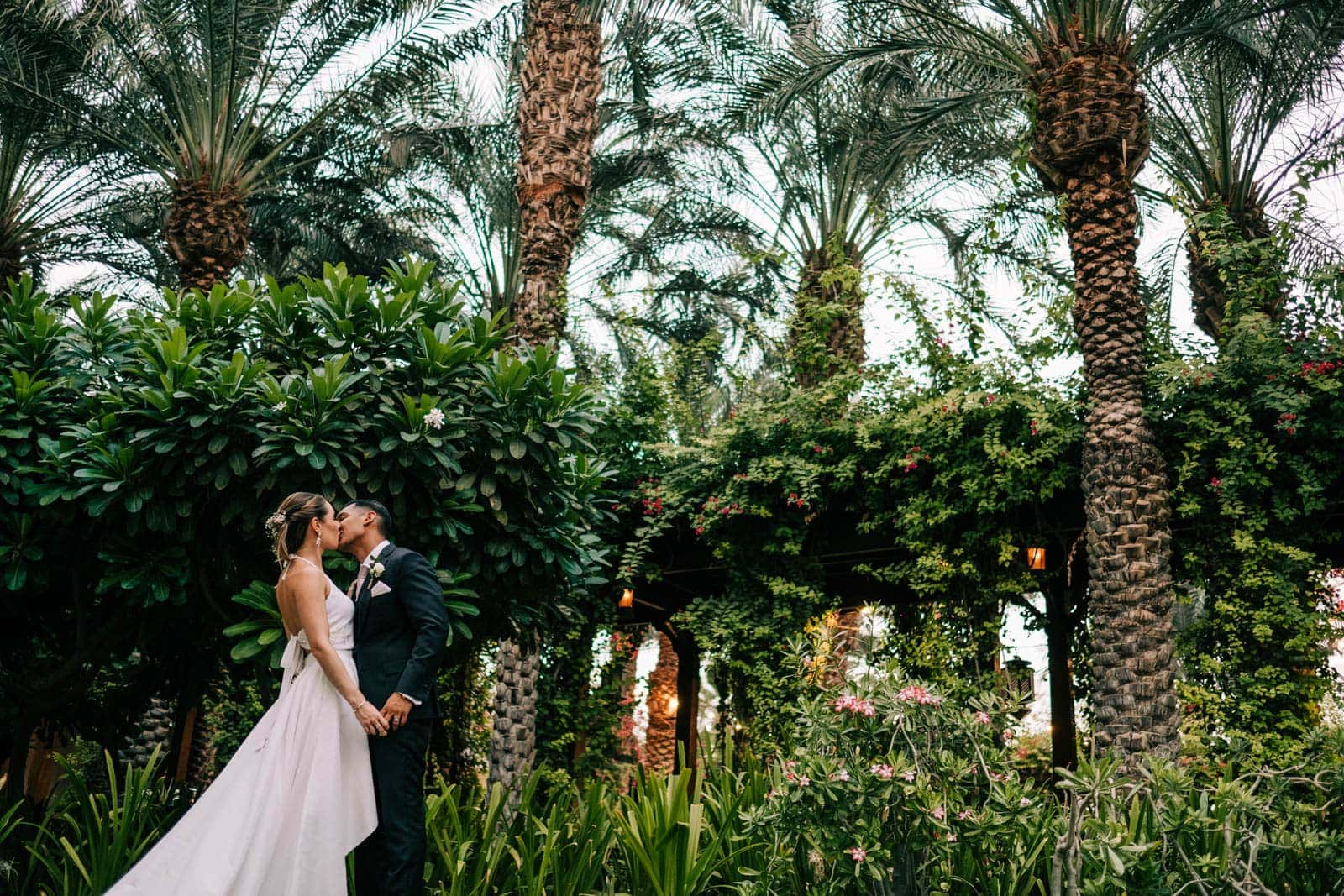 Bride and groom share a kiss in the Parky Hyatt Dubai's garden