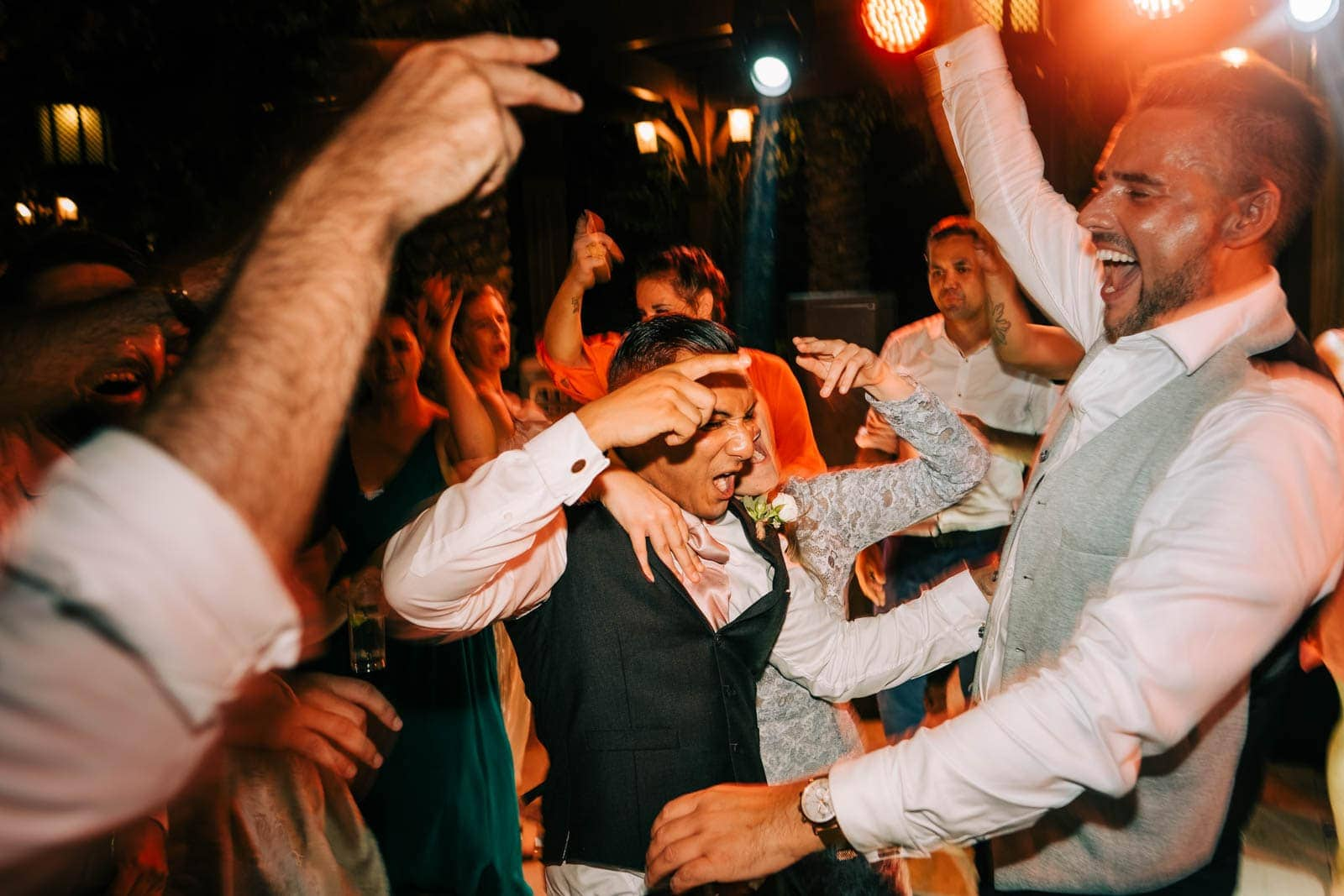 Groom partying on the dance floor
