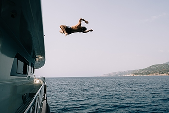 Guy jumping off a boat for the post wedding party