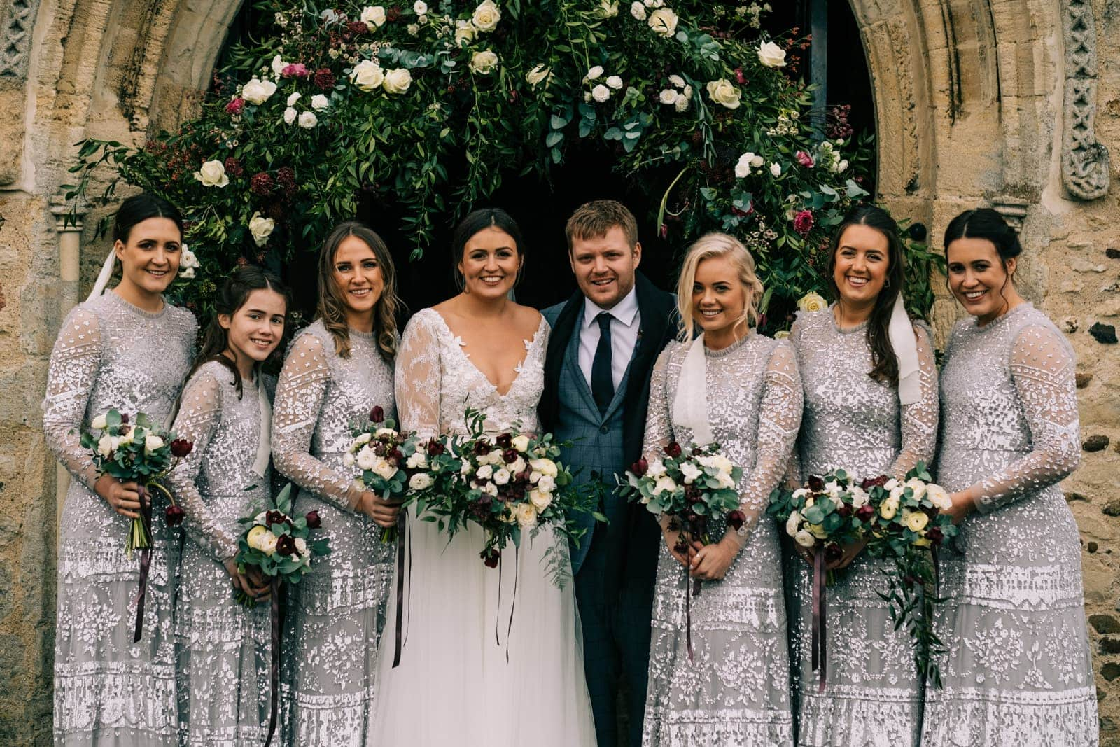Bride and groom with the bridesmaids