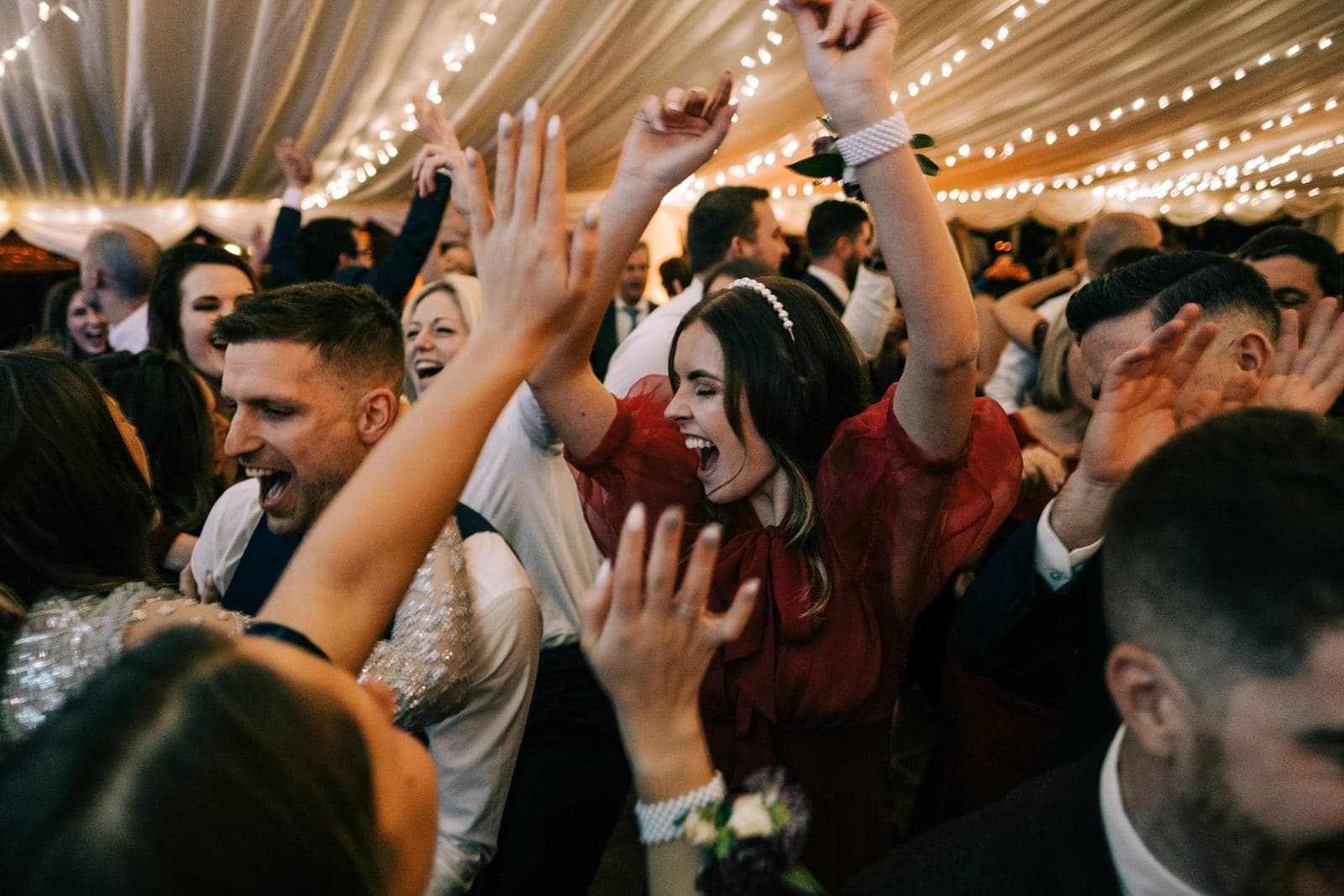 Wedding guest dancing on a packed dance floor