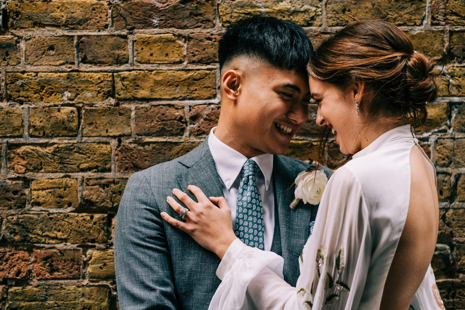 Bride and groom laugh during their portrait session in China Town