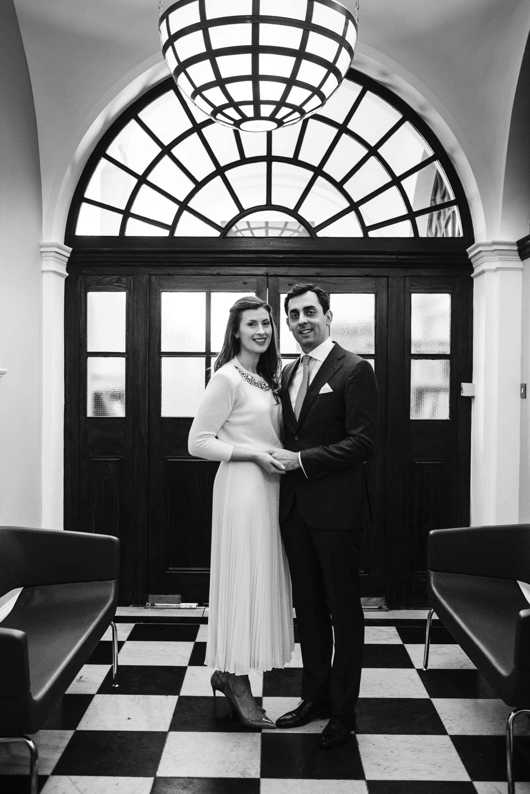 Bride and groom out the Chelsea Town Hall ceremony room